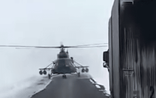 Military helicopter lands on road to ask trucker for directions