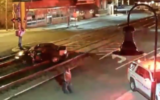Train pushes car from tracks