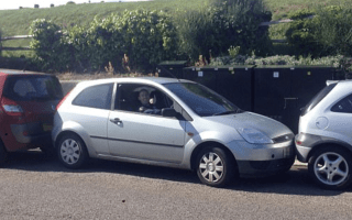 Determined motorist manoeuvres out of tiny space
