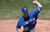 Blue Jays top AL East, Mariners shock Cubs