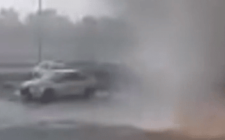 Car is picked up by tornado in repair shop parking lot