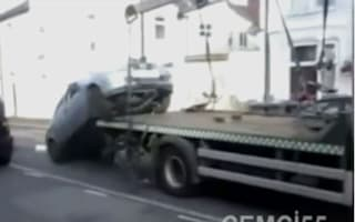 Furious motorist fires car off back of tow truck