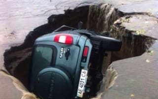 Giant sinkhole swallows Lada whole