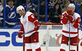Red Wings dumped out, Kane saves Blackhawks