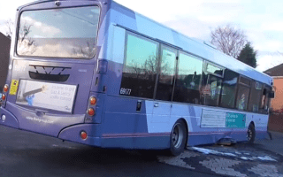 Driver beaches bus on roundabout after attempting shortcut