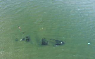 Aerial images show WW1 wreck emerging from sea