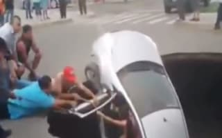 Sinkhole swallows family car in Peru (video)