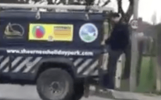 Bizarre footage shows drunk man trying to hitch ride on Land Rover