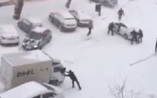 Video: Snow chaos as pedestrians can't stop sliding cars