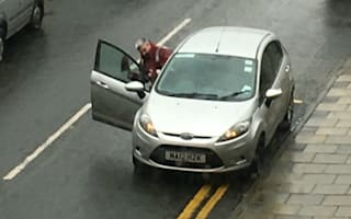 Traffic warden caught parking on double yellow lines