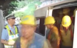 Police pull over van packed with 40 construction workers