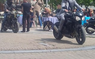 Motorcycles filmed speeding through busy Amsterdam market