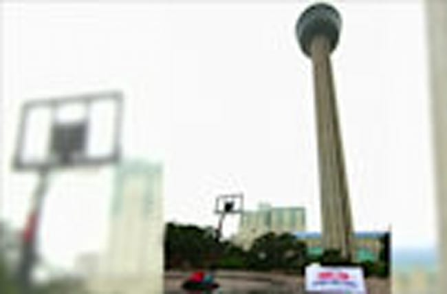 Basketball star shoots basket from top of tower