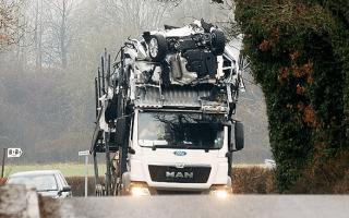 Transporter driver destroys fleet of new Fords
