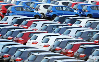 Sales dip as families pay off debts rather than buy new cars