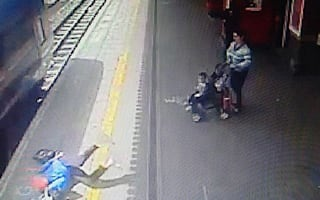 Woman dragged along train platform with hand stuck in door