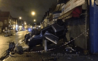Car flips over on busy road in Cardiff city centre