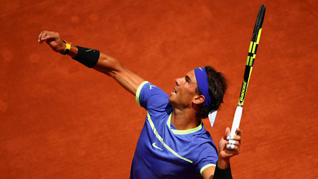 Nadal through to semis as Carreno Busta quits