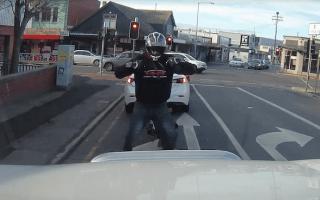 Tasmanian motorcyclist dances at red light