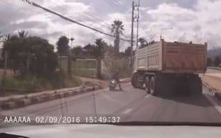 Moped rider falls under 20-tonne truck - and survives