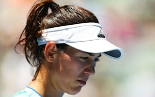 Muguruza crashes out on another wet day in Doha