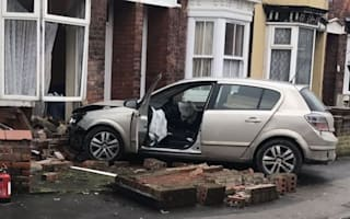 Two left injured after car smashes into house