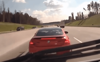 BMW driver blocks path of ambulance on busy highway