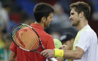 Out-of-sorts Djokovic thwarts qualifier Zverev