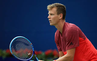 Berdych on course, Thiem crashes out