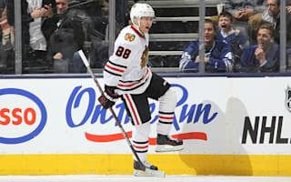 Kane strikes three to lead Blackhawks to victory