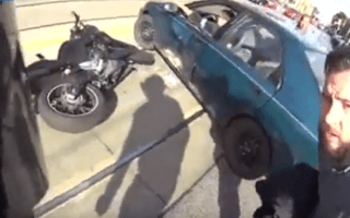 Wheelie painful! Biker is thrown over handlebars by car
