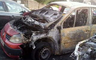 Couple escape car as it is engulfed in flames