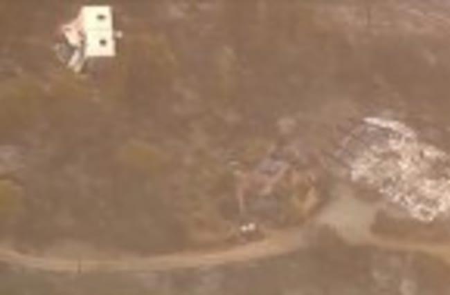 Santa Cruz brush fire threatens homes