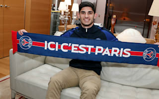 Guedes arrives in Paris ahead of PSG switch