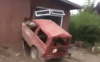 Watch as builders use an old Suzuki jeep to knock down a house