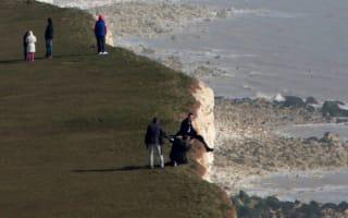 'Idiotic' men sit at edge of 500ft crumbling Beachy Head cliff