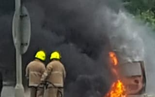 Couple forced to leap from their car after it burst into flames