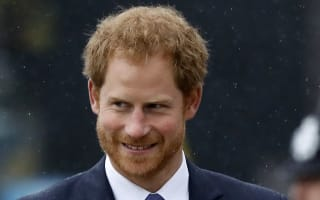 Angry Prince Harry lashes out at 'abuse' of his actress girlfriend Meghan Markle