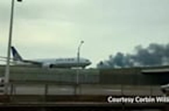 Smoke fills the air after jet blows tire on takeoff at Chicago airport