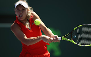 Wozniacki into last eight as Stosur loses
