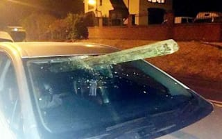 Lucky cabbie survives stake through windscreen