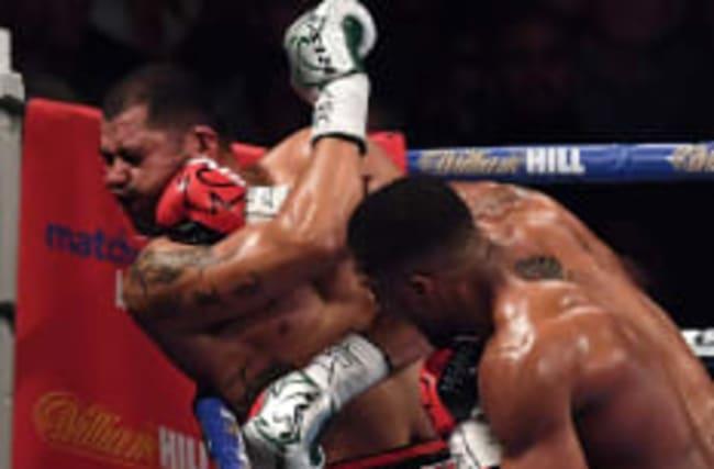 Joshua beats Molina to retain world heavyweight title