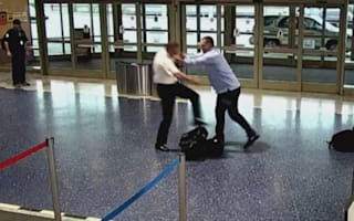 Angry passenger shoves pilot in airport terminal