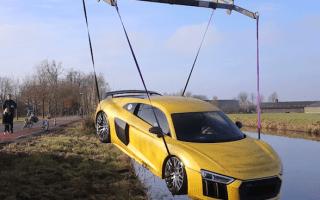 German motorist crashes Audi R8 into river