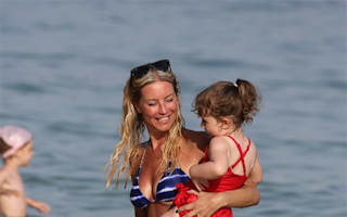 Denise Van Outen hits the beach with daughter in Majorca