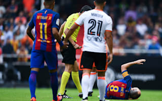 Fears for Iniesta as Barcelona captain goes off on stretcher