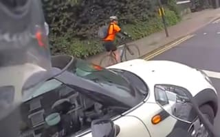 Video: Motorist spotted eating cereal and using phone at the wheel