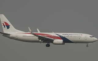 Malaysia Airlines plane aborts takeoff to avoid collision