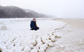 Giant natural snowballs appear on remote beach, baffling residents