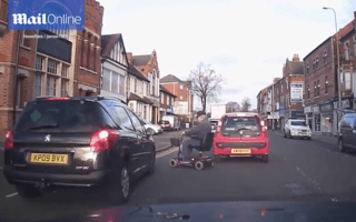 Elderly man on mobility scooter narrowly avoids being hit by car